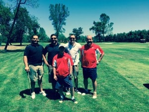 John Karpinski, Dan Landis and Tyler Whitlow from Omega Mortgage Group golfing with members of the Shasta County Special Olympics.